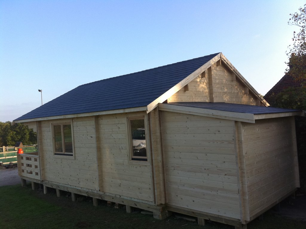 View of the completed twinskin cabin with storage cabin to rear