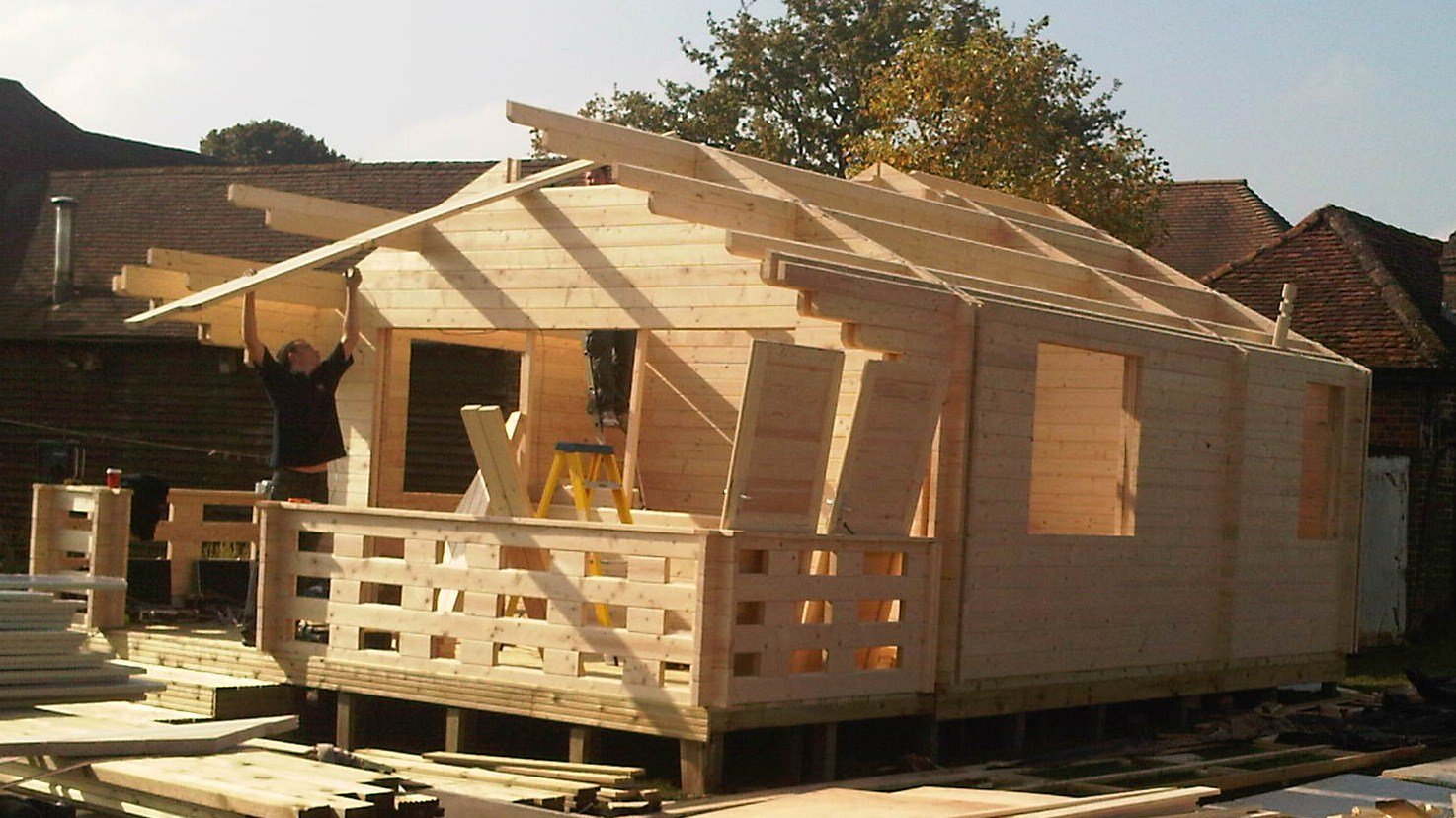 Cabin walls are completed and the roofing beams are now being fitted
