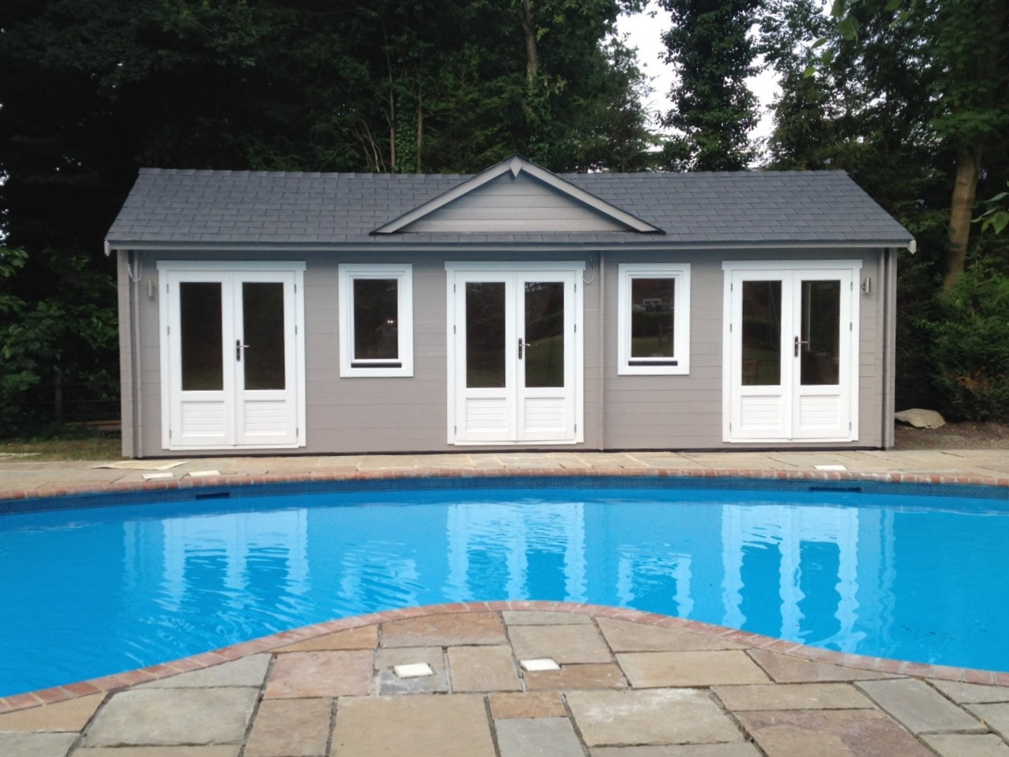 Norfolk Cabin' adapted to accommodate a pool house with a separate changing room